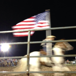 Cowboy with American Flag at Ottowa Farms Rodeo - Hearts and Laserbeams